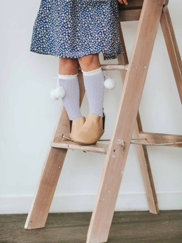 KNEE HIGH LILAC WITH SNOW POM POM SOCKS