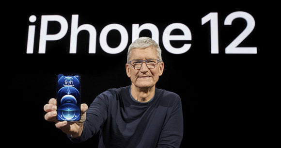 Tim Cook holding the new iPhone 12 at the October Apple event.