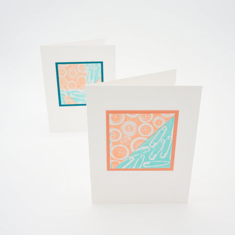 blank notecards - stamped buttons and safety pins in orange and teal