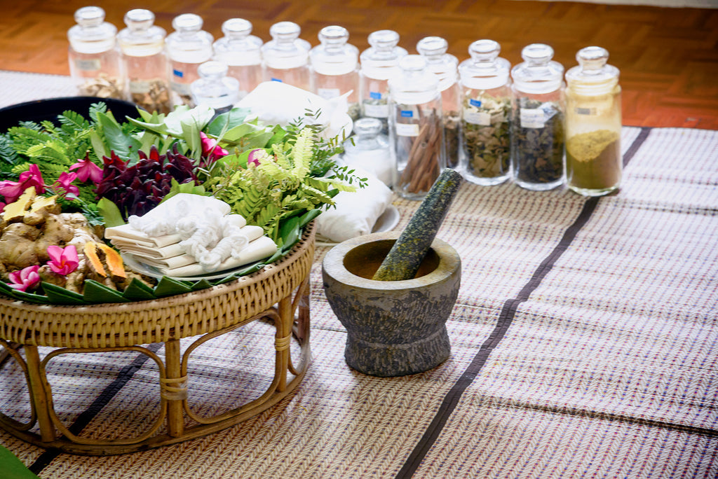 A basket full of foods, herbs, spices and natural medicine used in Indian Ayurvedic medicine.