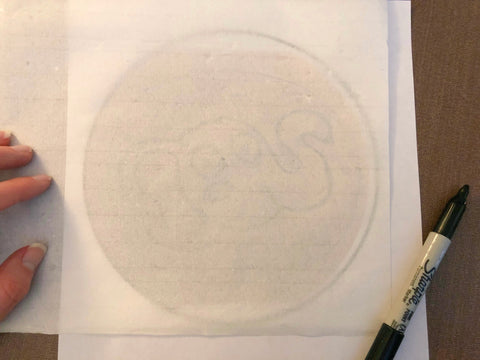 Tracing your original sketch to translucent paper.