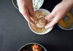 Rolling the scotch egg in breadcrumbs