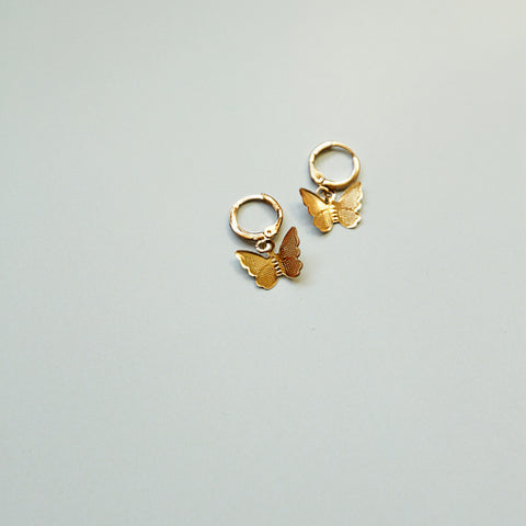 Happy, Free, Confused and Lonely Huggies - Gold Butterfly Huggie Earrings - Flat Lay | Sundree Accessories