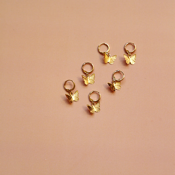 Happy, Free, Confused and Lonely Huggies - Gold Butterfly Huggie Earrings - Group Flat Lay | Sundree Accessories