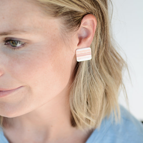 The Ryan Studs - Geometric Pink Striped Stud Earrings - Model Close Mouth Smile | Sundree Accessories