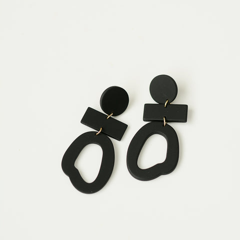 Confidential Drops - Three Tier Black Statement Drop Earrings - Flat Lay | Sundree Accessories