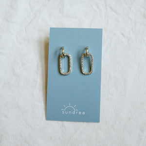 Club 33 Hoops - Gold Hoop Earrings With An Oval Rhinestone Charm - Flat Lay On Card | Sundree Accessories