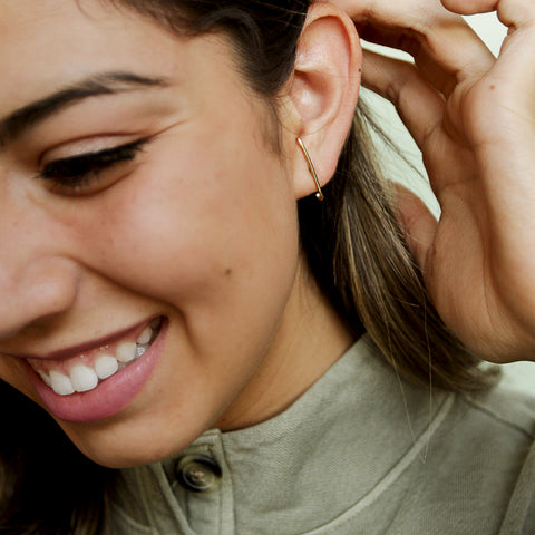 I Think He Did It Studs - Skinny Gold Wrap Around Stud Earrings - Model Smiling | Sundree Accessories