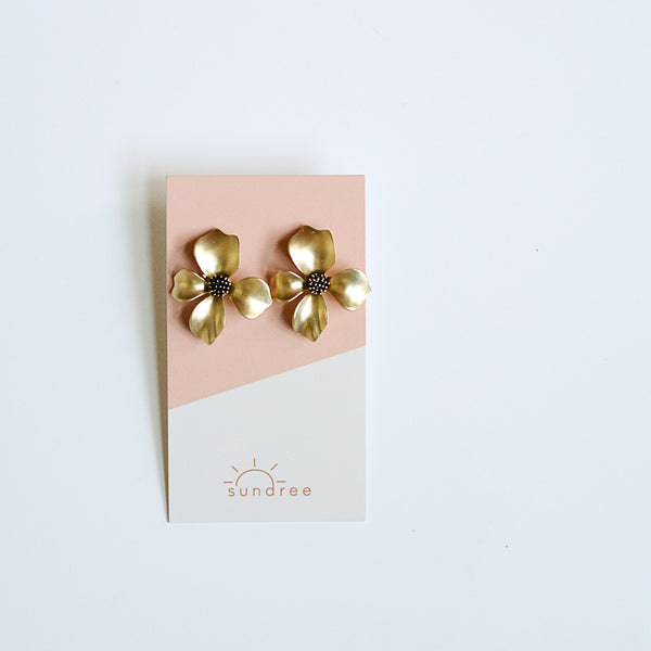Match Of The Season Studs - Metal Flower Oversized Studs - Gold Stud Earrings Flat Lay On Earring Card | Sundree Accessories