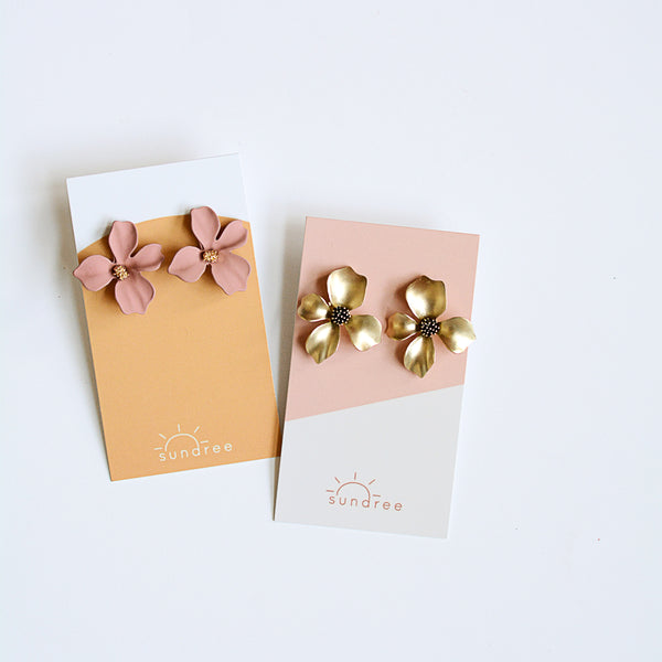 Match Of The Season Studs - Metal Flower Oversized Studs - I Blushed And Gilded Flat Lay Two Pairs Of Earrings On Earring Cards | Sundree Accessories