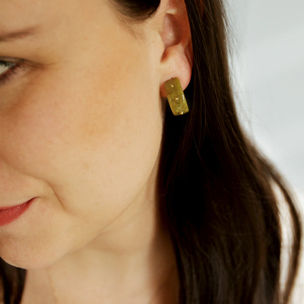 Grocery Pickup Hoops - Olive Green Resin Hoops With Tiny Gold Studs - Model Closeup | Sundree Accessories