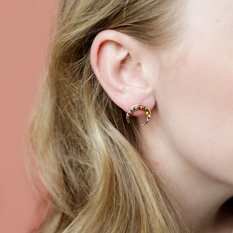 The Antoni Studs - Gold Crescent Earrings Lined With Rainbow Gems - Model Closeup Detail | Sundree Accessories