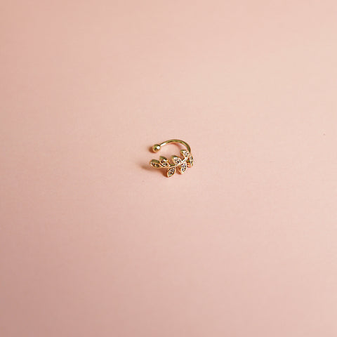 Ridin' Solo Cuff - Gold + Rhinestone Leaf Ear Cuff - Flat Lay Pink Background | Sundree Accessories