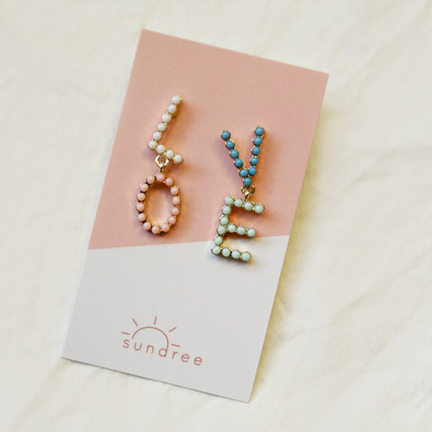 You Killed Our Love Fern Drops - Beaded L-O-V-E Drop Earrings - Flat Lay | Sundree Accessories