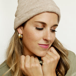 Wash And Fold Hoops - Matte Gold Hammered Hoop Earrings - Model Looking Down | Sundree Accessories