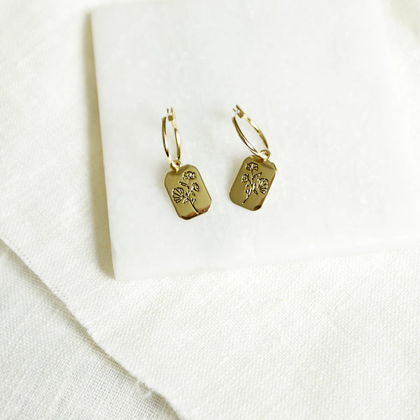 P.S. I Love You - Gold Flower Stamped Rectangle Charm Hoops - Earring Flay Lay White Background | Sundree Accessories