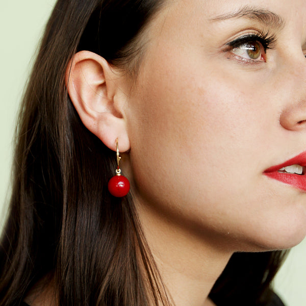 Eating Because I'm Bored Hoops - Red Ball Charm Gold Hoop Earrings - Model Closeup Detail | Sundree Accessories