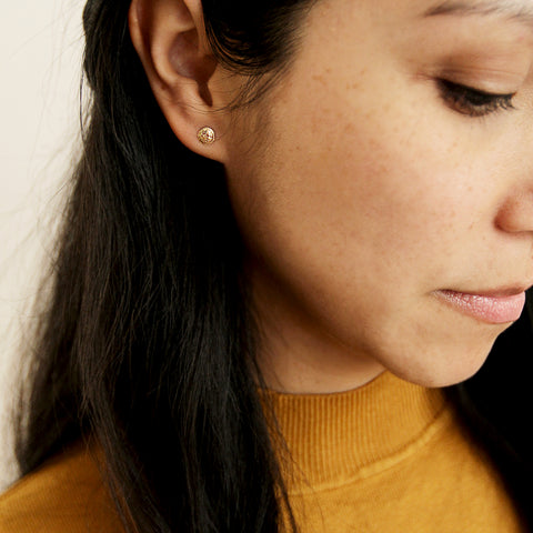 A Thousand Times Yes Studs - Gold Filled Tiny Sand Dollar Stud Earrings - Model Looking Down | Sundree Accessories