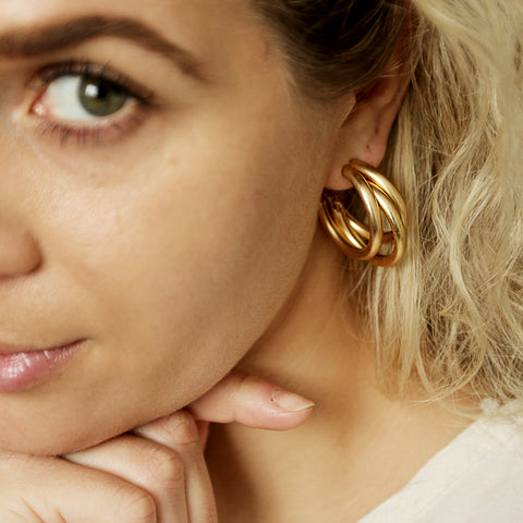 Karen Hoops - Mid-Size Gold Triple Hoop Earrings - Model Looking At Camera | Sundree Accessories