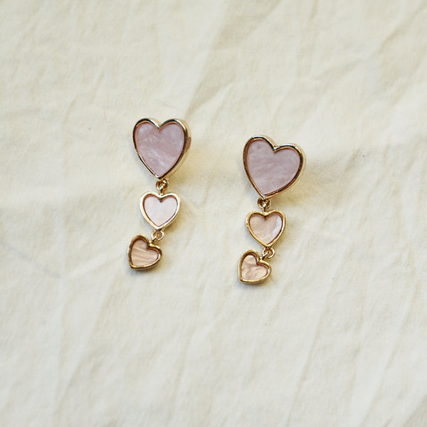 Not Cocky, Confident Drops - Light Pink Cascading Heart Drop Earrings - Flat Lay | Sundree Accessories