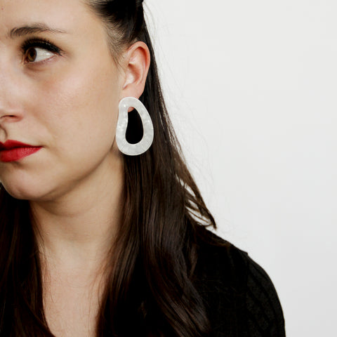 TP Shortage Drops - Bold White Resin Drop Earrings - Model Looking To The Side | Sundree Accessories