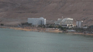 AD_004 Aerial helicopter footage of the Dead Sea: High angle Dead Sea hotels