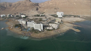 AD_005 Aerial helicopter footage of the Dead Sea: High angle sink holes on Dead Sea west coast