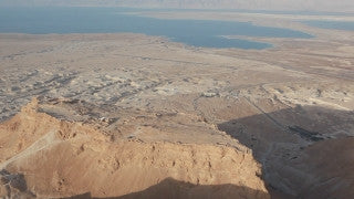 AD_018E Aerial helicopter footage of Dead Sea and Masada: Masada with Dead Sea in background