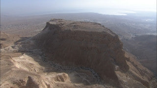 AD_021 Aerial helicopter footage of the Dead Sea and Massada: Massada and Dead Sea in background