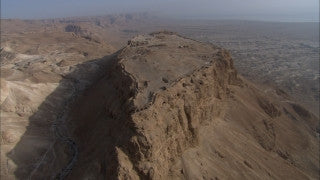 AD_022 Aerial helicopter footage of the Dead Sea and Massada: Massada and Dead Sea in background