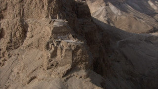 AD_024 Aerial helicopter footage of Massada: zoom in on archeological site