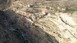 AD_032 Aerial helicopter footage of Israel: low altitude Marsaba monastery in the Judean Desert