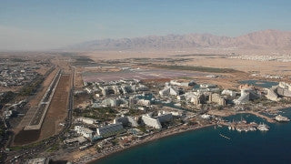 AE_007E Aerial helicopter footage of Eilat: resorts and coast line
