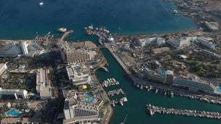 AE_001E Aerial helicopter HD footage of Eilat: Eilat Bay and city