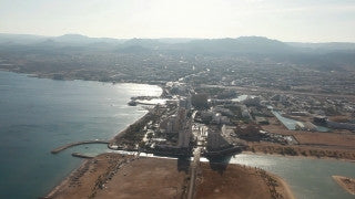 AE_012 Aerial helicopter footage of Eilat: beach and underwater marine museum