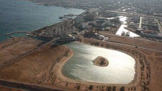 AE_014 Aerial helicopter footage of Eilat: city and laguna from the east
