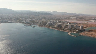 AE_004E Aerial helicopter footage of Eilat: hotels and beach from the east