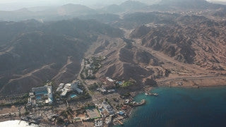 AE_005E Aerial helicopter footage of Eilat: laguna and hotels