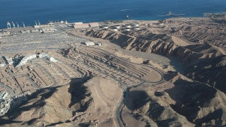 AE_009E Aerial helicopter footage of Eilat: mountains and port area