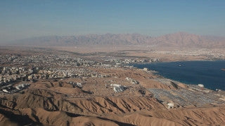 AE_010E Aerial helicopter footage of Eilat: mountains and port area