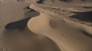 AE_016 Aerial helicopter footage of Southern Israel: Sand dunes and mountains in the Negev Desert