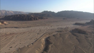 AE_018 Aerial helicopter footage of Southern Israel: creeks and mountains in the Negev Desert