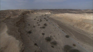 AE_021 Aerial helicopter footage of Southern Israel: creeks and mountains in Zin, the Negev Desert
