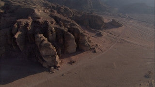 AE_025 Aerial helicopter footage of Southern Israel: Timna Valley and mountains in the Negev Desert