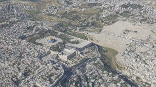 AJ4K_026 - Aerial 4K footage of Jerusalem: The security wall (separation wall) around east Jerusalem and Abu Dis