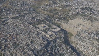AJ4K_030 - Aerial 4K footage of Jerusalem: vertical aerial shot of the separation wall in Abu Dis, east Jerusalem