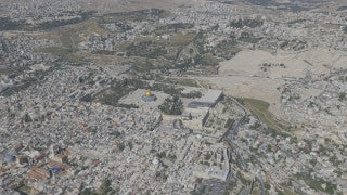 AJ4K_034 - Aerial 4K footage of Jerusalem: An aerial shot of the separation wall in east Jerusalem, looking toward Juaean Desert