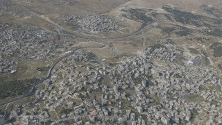 AJ4K_031 - Aerial 4K footage of Jerusalem: An aerial shot of the separation wall in south-east Jerusalem