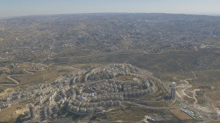 AJ4K_035 - Aerial 4K footage of Jerusalem: The neighborhood of Har Homa with the separation wall and Beit Sahour in the background