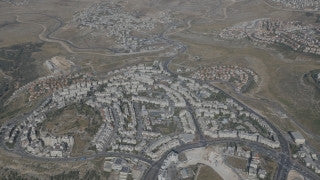 AJ4K_040 - Aerial 4K footage of Jerusalem: the eastern outskirts of greater Jerusalem, with Ma'ale Edomim and the Judean desert.